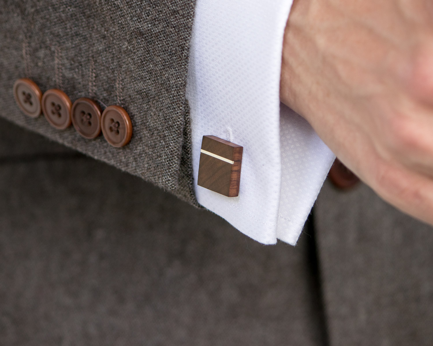 Walnut & Sterling Silver Cufflinks being worn with a suit